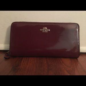 Coach wallet: burgundy-women's-long zip around